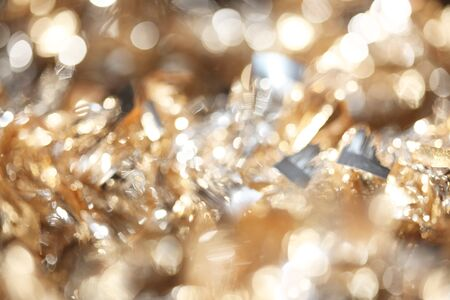 Abstract bokeh of sparkling gold and silver Christmas tinsel background 版權商用圖片