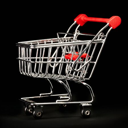 Single chrome and red shopping cart on black