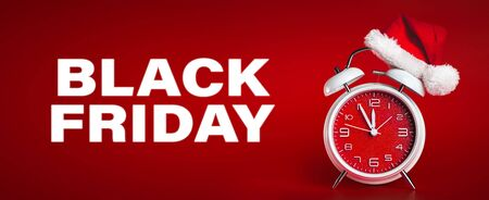 Red clock with Christmas Santa hat and Black Friday text. Time for Christmas shopping concept.