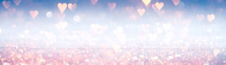 Romantic wallpaper. Sparkling pink hearts on shiny silver and blue background. For love, romance, or Valentine's day. 版權商用圖片