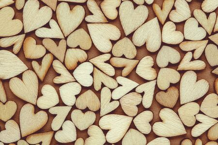 Romantic  of dozens of tiny wooden hearts for love, romance, or Valentine's Day. 版權商用圖片