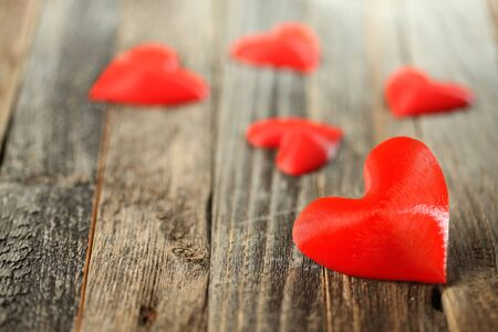 Red hearts on old wooden planks