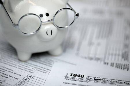 US Tax forms with piggybank