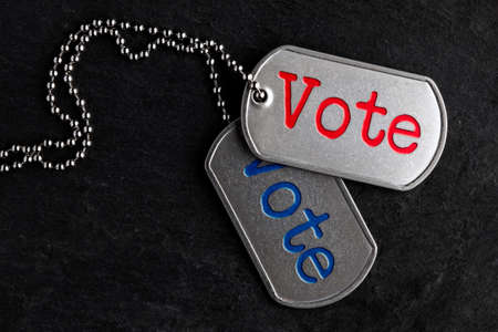 Old and worn military dog tags - Vote