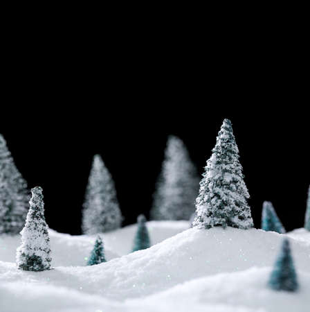 Winter wonderland with trees and sparkling white snow. Blank space above for text. 版權商用圖片