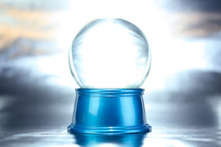 Blank empty snowglobe. Glass snow globe on blue base.