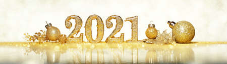 2021 in sparkling gold numbers celebrating the New Year or Christmas with glittering ornaments and decorations