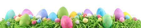 Painted Easter eggs and decorations on arranged on Easter grass.