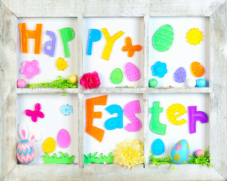 Happy Easter decorations in old wooden window