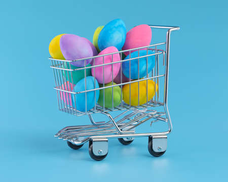 Colorful Easter eggs piled in shopping cart for Easter shopping.