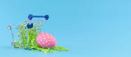 Pink Easter egg in shopping cart for Easter shopping concept.
