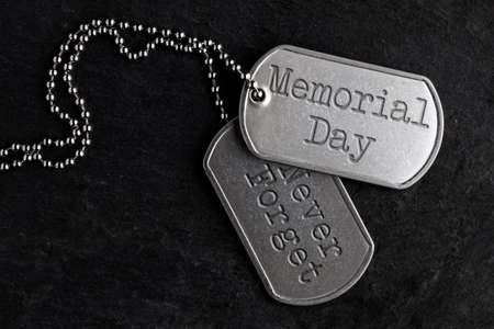 Old and worn military dog tags - Memorial Day, Never Forget