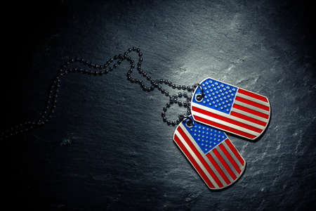 US military dog tags in the shape of the American flag. Memorial Day for Veterans Day concept.