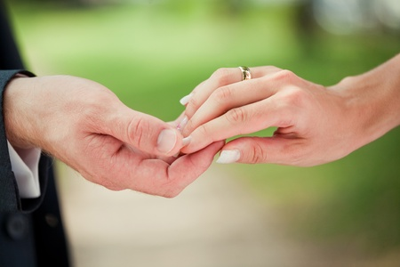 Bride and groom holding hands after they got married photo