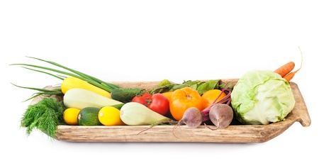 Assorted Vegetables in an old wooden platter photo