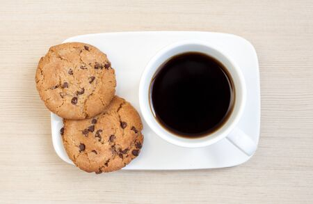 black coffee with cookies on wooden background photo