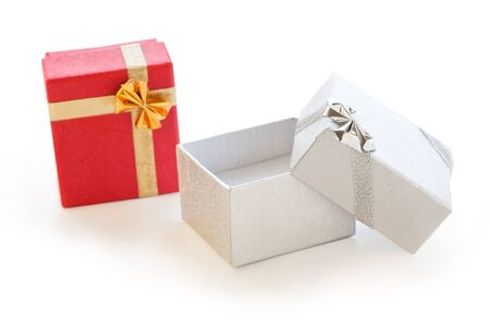 Two gift boxes red and silver on white background photo