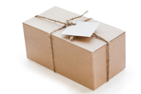 box of brown cardboard, tied with string and with blank label photo