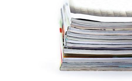 periodical: stack of magazines on white background Stock Photo