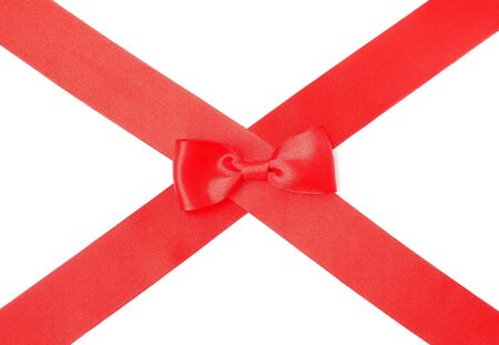 Red satin ribbon with bow on white background  photo