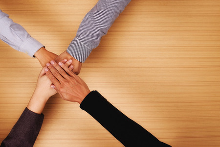 Teamwork,Business team standing hands together in the office with copy space.Business people joining hands together.People Teamwork hands together,teamwork online.business teamwork,join hands together