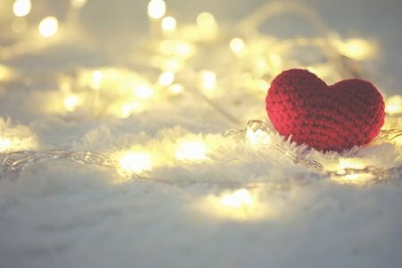Red heart and Love Valentines day on white bokeh background. Stock Photo