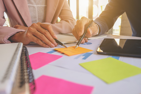 group  accountant: Business concept. Business people discussing the charts and graphs showing the results of their successful teamwork. Selective focus. Stock Photo