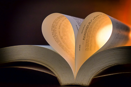 shaped: Book with pages in heart shape over luminous background,Valentines day concept
