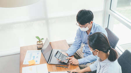 Beautiful Asian Business Using Laptop Computer Online Working from Home