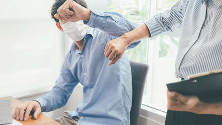 Asian People Successful Teamwork Business Wearing Medical Mask and Working. Work from Private Office Social Distancing among  Outbreak Situation