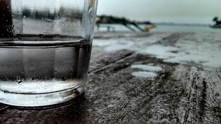 A glass of water on the rain