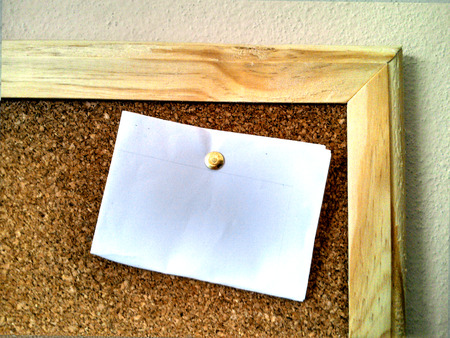 Cork board part with a white blank paper photo
