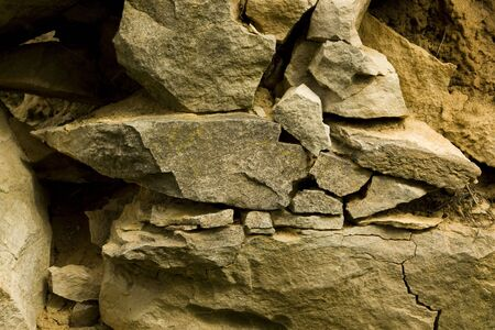 blasted: old stone wall with the blasted laying