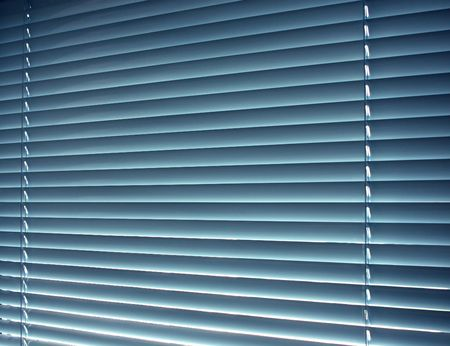 jalousie: Sun-protection jalousie of blue color in a bright sunny day Stock Photo