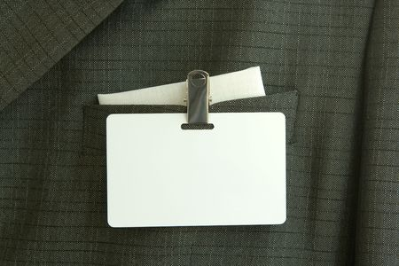 authorisation: Business man in  suit with name tag, insert your own text etc.