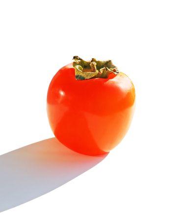 Orange ripe persimmon isolated over white background photo