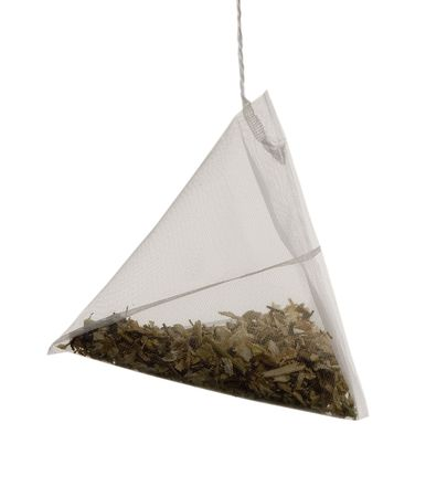 tea bag as a pyramid of on  white background photo