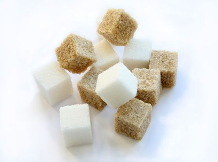 brown and white sugar isolated on a background photo