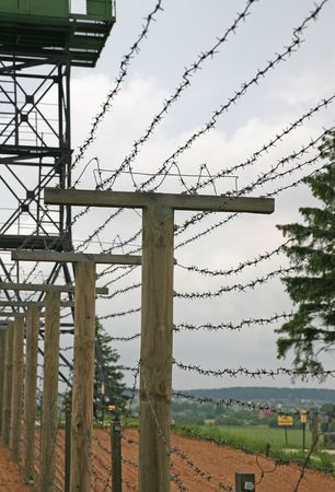 Barbed wire fence with clouds in background - frontier protection Stock Photo - 5184552