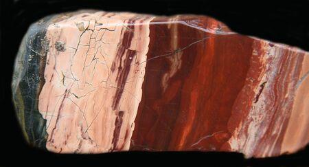 The cut and polished stone of a jasper photo