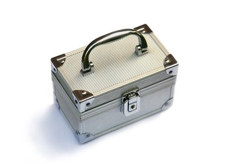 Silvery suitcase on a white background photo