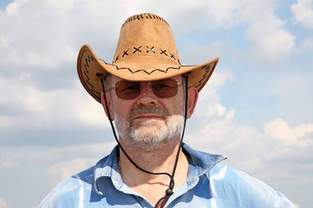 The man in a cowboys hat against the blue sky photo