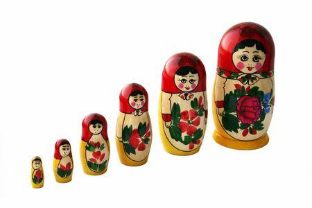 Russian Babushka nesting dolls, isolated on white photo