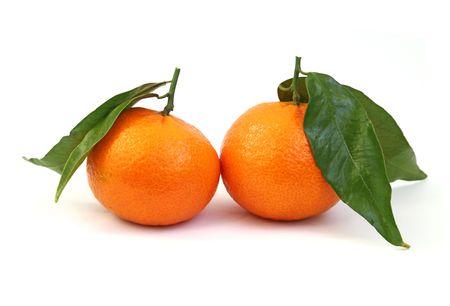 Shot of an orange mandarins fruit with leaf. Isolated on white background. photo