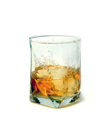 Ice falls in a glass of whisky photo
