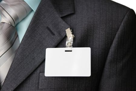 close up of black suit with id card photo