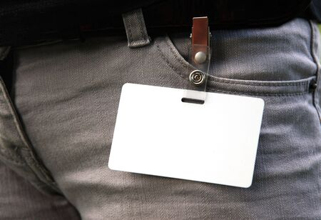 Blank namebadge on a pocket of jeans of the girl - inserts your own mark and the information photo