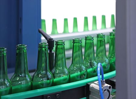 Technological line for washing of glass bottles for beer photo
