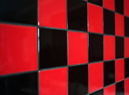 sharpness: Wall with a red and black tile. The limited sharpness