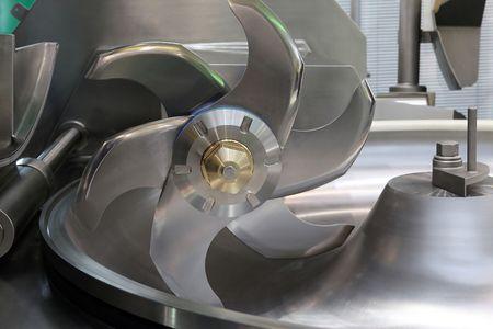 Industrial meat grinder close up - mincing-machine Imagens